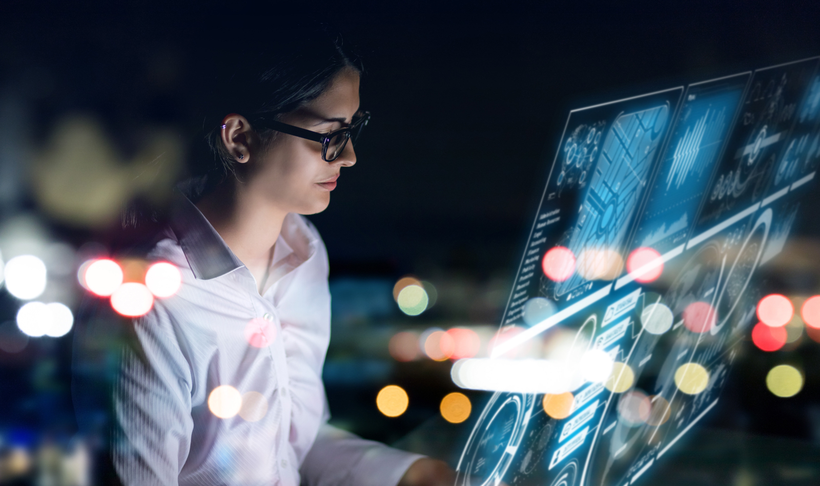 Woman Looking at Futuristic Analytics Screen
