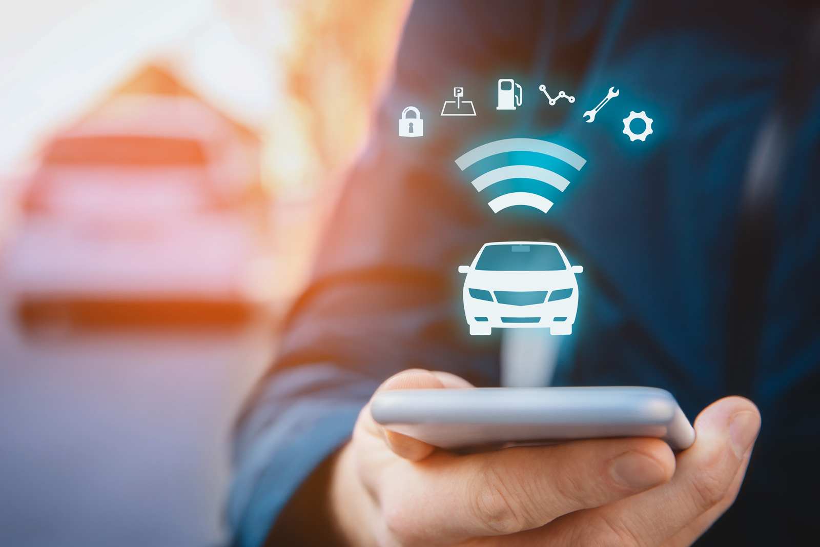Man Holding Phone with Connected Vehicle Icons